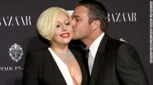 150216171923-getty-bazaar-lady-gaga-taylor-kinney-large-169